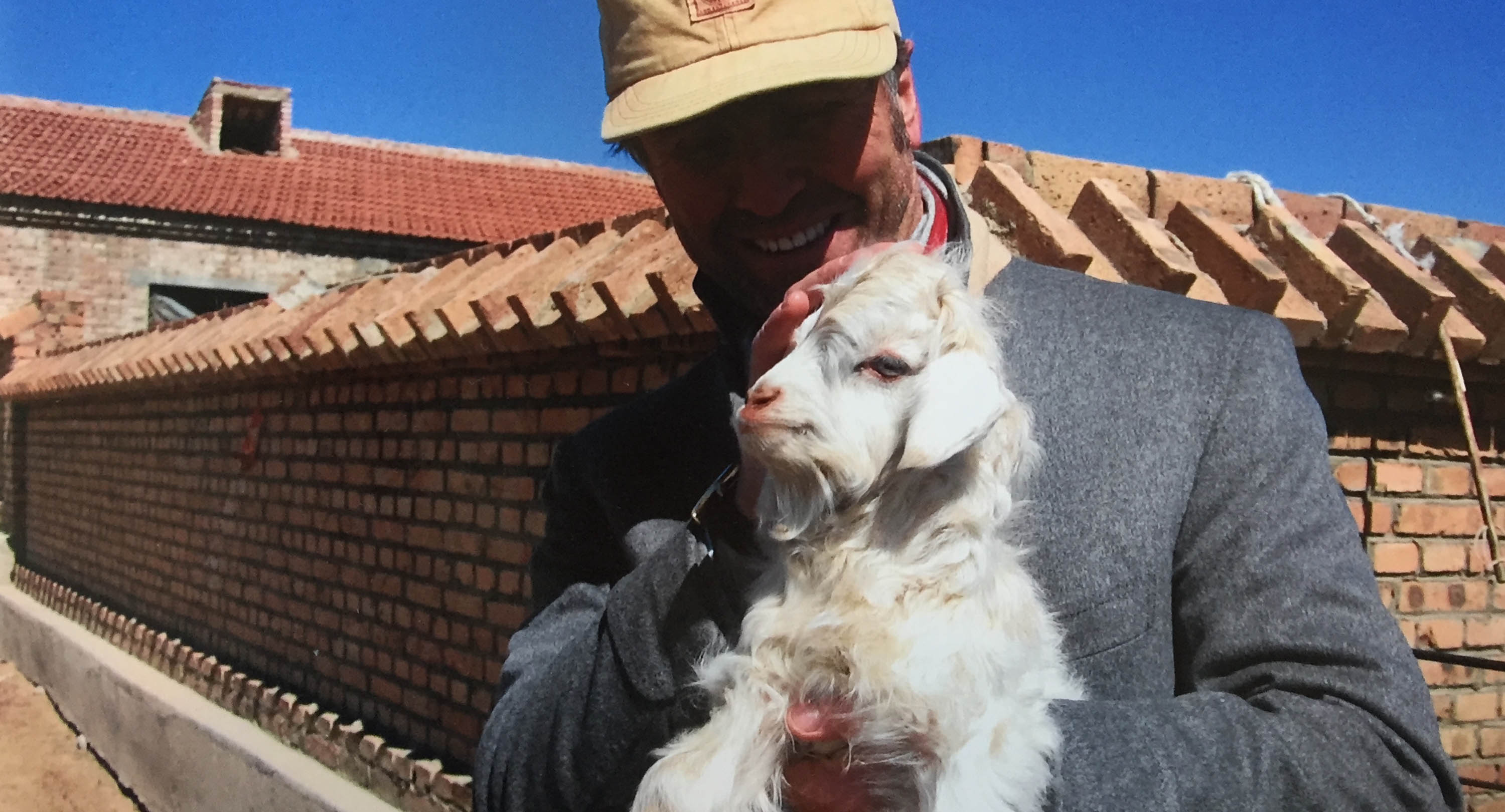 Brunello Cucinelli and a baby  cashmere goat